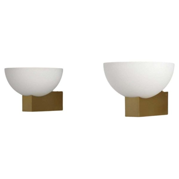 A pair of French Art Deco Bronze and White Glass Sconces by Jean Perzel